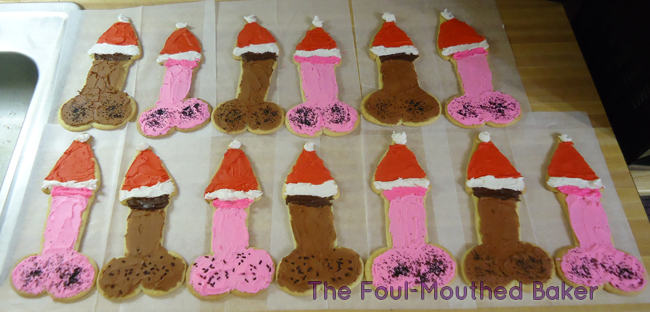 On the 13th day of Jeebus' birthday, my baker gave to me: 13 cock cookies wearing lil' Santa hats on their heads.